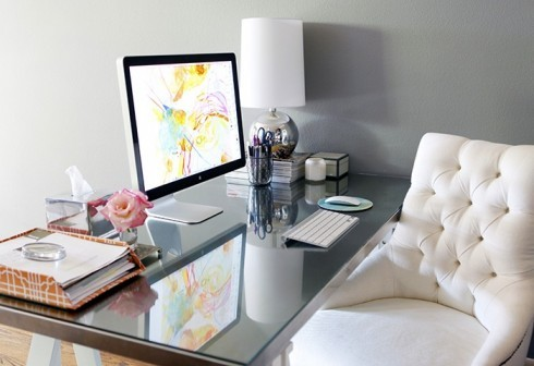 tufted white office chair and glass topped desk