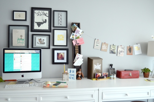 A lovely arrangement of art over her desk adds personality and inspiration (via Kimberly AH)