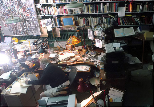 William F. Buckley at the eye of his personal paper storm.