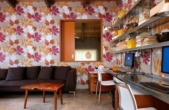 Mid Century made modern with vibrant wallpaper and metal work surfaces via The Decoist
