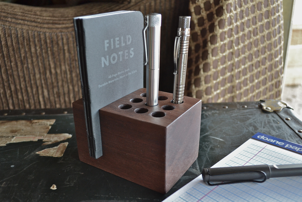 Handmade walnut pen and pocket notebook holder $55. Other configurations available (via Clicky Post)